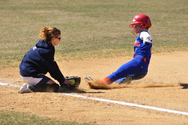 MIKE FEIFEL/TIMES NEWS Jim Thorpe's Talia Valentini is tug out trying to steal third base in the second inning by Northern Lehigh's Cassie Toth.