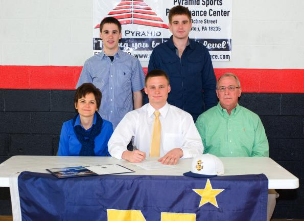 Jon Strauss (front row, center) signs a Letter of Intent to attend the US Naval Academy. Strauss, a 2012 Lehighton High School grad, will continue his academic and track careers with the Midshipmen. Sitting next to Strauss for the signing are his…