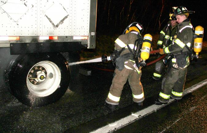 ANDREW LEIBENGUTH/TIMES NEWS A tractor trailer belonging to Fed-Ex caught fire near miler marker 31 of Interstate 81 around 11 p.m. Monday after the driver reported his truck was on fire. Officials on scene stated that the fire, which started from…