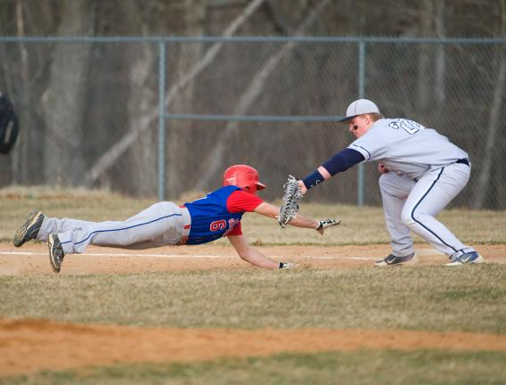 bob ford/times news Tamaqua's Troy Reinhardt tags out Jim Thorpe's Nick Montanaro on a pickoff play at first base.