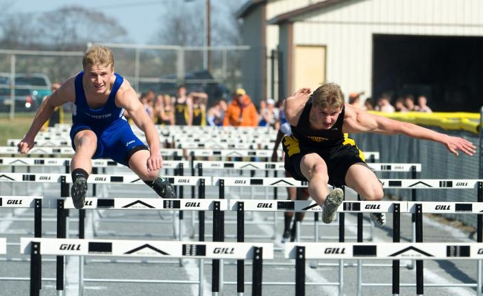BOB FORD/TIMES NEWS Palmerton's Austin Shupp and Northwestern's Austin Weiss are pretty even in the 110 high hurdles during Tuesday's Colonial League meet. Shupp wound up the winner with a time of 16.2.