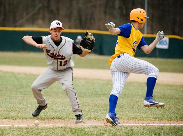 bob ford/times news Weatherly pitcher Brett Stallone (left) moves in to scoop up the ball as Marian's Justin Bilka tries to avoid contact running down the first base line.