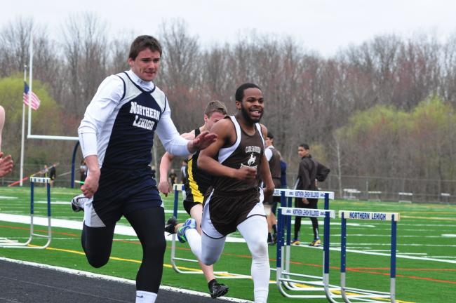 mike feifel/times news Northern Lehigh's Caleb Johnson (left) and Catasauqua's Ra'Von Burton sprint toward the finish line in 100 meters.