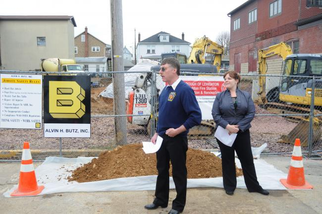 @Caption Stand Alone:Speaking at groundbreaking ceremony Lehighton Fire Chief Gary Frable speaks during groundbreaking program for fire station addition in Lehighton. Looking on is Lehighton Borough manager Nicole Beckett.