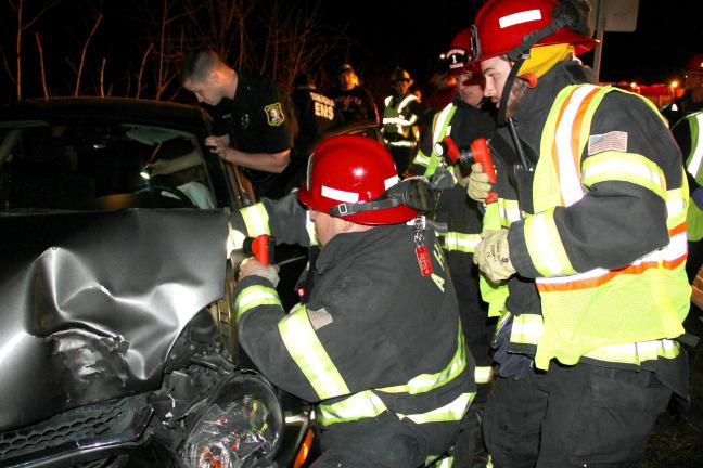 ANDREW LEIBENGUTH/TIMES NEWS Tamaqua firefighters cut the battery to the vehicle.