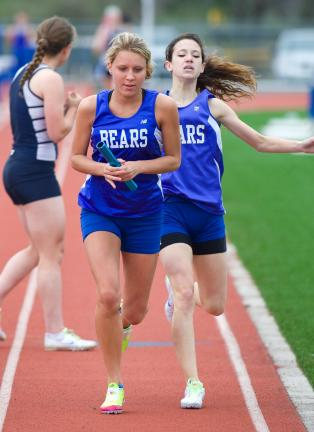 BOB FORD/TIMES NEWS Pleasant Valley's Sam Young hands off to Abigail Kaspszk in the 3200 relay. The Bears won the event in 10:35.49.