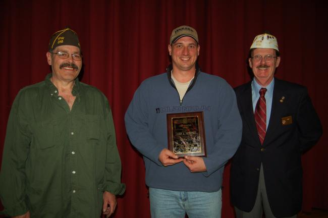 Gail Maholick/TIMES NEWS Lehighton VFW Post 256 names Jason Nothstein as the 2013 Firefighter of the Year. From left are, Kenneth Repsher, VFW commander; Nothstein; and Harry Wynn III, past commander.