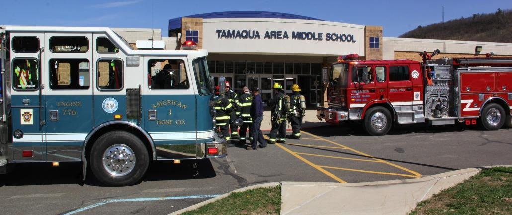 ANDREW LEIBENGUTH/TIMES NEWS Students and staff at the Tamaqua Middle School were evacuated outside yesterday afternoon after the fire alarm was set off. Schuylkill communications said the signal came from a pull box inside the school. Firefighters…