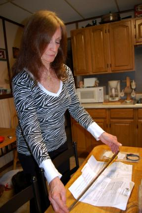 Gail Maholick/TIMES NEWS Geralyn Lyons of Weissport displays the arrow that went through her cat Pepe.