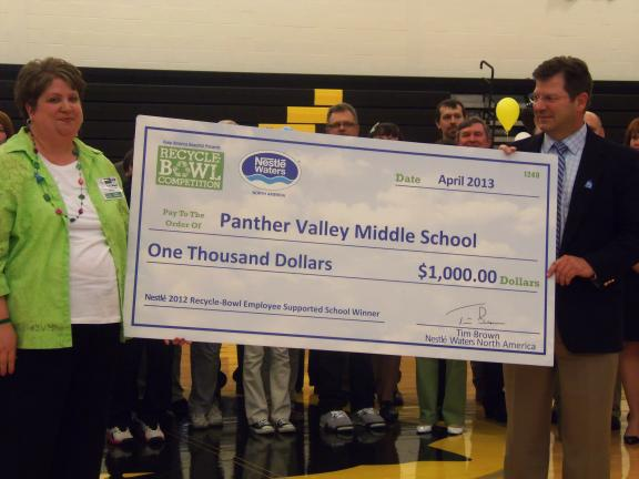 CAROL ZICKLER/SPECIAL TO THE TIMES NEWS Lisa Mase, Panther Valley Middle School principal, accepts a check from Peter Rittenhouse, supply chain director for Nestlé Water North America in PA, totaling $1,000 for the school's Recycling Club…