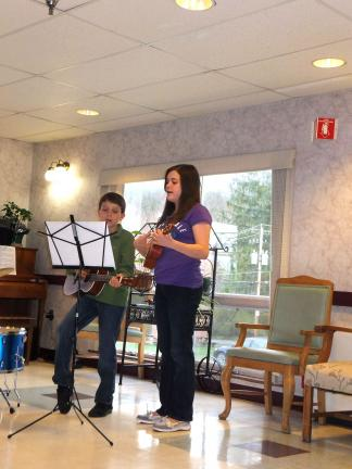 STACEY SOLT/TIMES NEWS Elliot Roberti, left, and Emily Roberti, perform during a talent show in The Summit at Blue Mountain Health System. The show was inspired by one youngster's visit to The Summit last month. The Roberti siblings are students at…