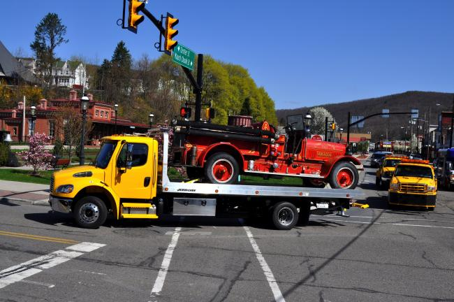 DONALD R. SERFASS/TIMES NEWS A flatbed carrying Tamaqua's oldest surviving motorized fire apparatus early Friday rounds the Five Points intersection on the final leg of a 999-mile journey from Florida.