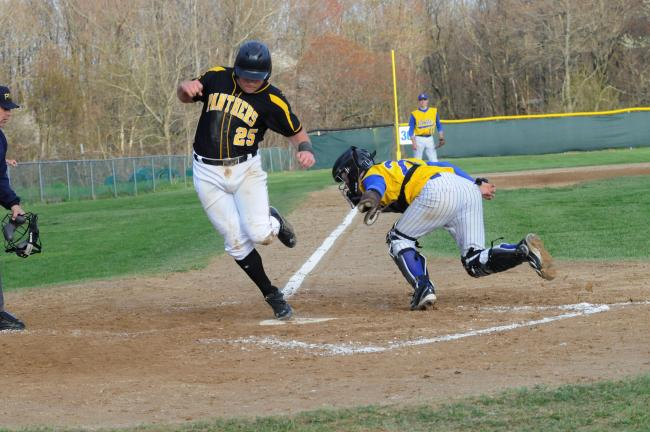 RON GOWER/TIMES NEWS Panther Valley's Mark Williams scores in the seventh inning, eluding an effort to tag him by Marian cacher K. J. Snerr.