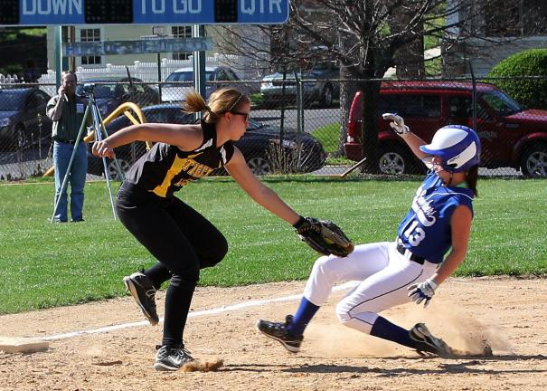 rich george/special to the times news Palmerton's Jordan Boyer slides into third base and is tagged out by Northwestern's Nicole Metzger.