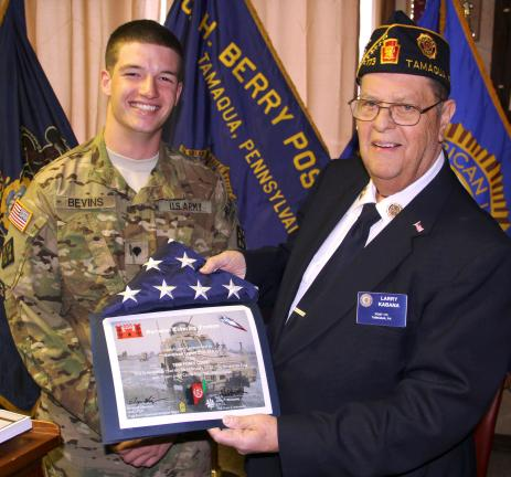 ANDREW LEIBENGUTH/TIMES NEWS SPC Joseph Bevins of Coaldale receives a welcome cerficate from Tamaqua American Legion Post Commander Larry Kabana. In return, Bevins surprised the post by giving them a flag flown over Afghanistan.