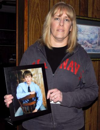 RON GOWER/TIMES NEWS Karen Flexer of Lehighton holds photo of her son, Brett, who died two years ago at the age of 20 when he mixed a prescription drug with alcohol.
