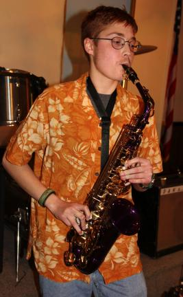 ANDREW LEIBENGUTH/TIMES NEWS Visitors were treated to singing, dancing and instrumental talents during Thursday's free open stage event held at the Tamaqua Community Arts Center. James Diprima, 19, performs on the sax.