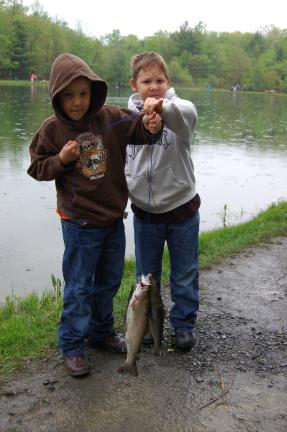 "Gail Maholick/TIMES NEWS Ben and Eli Imler show off their fish they cause at the Blue Mountain Fish and Game ""Day at the Lake"" event."