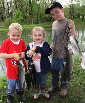 ANDREW LEIBENGUTH/TIMES NEWS Proudly displaying their fish are, from left, Jacob Taylor, 3; Lilly Carl, 3; and Stephen Baker, 7.
