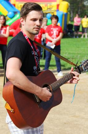 ANDREW LEIBENGUTH/TIMES NEWS Tamaqua elementary school teacher Dylan Peters plays the National Anthem prior to the event.