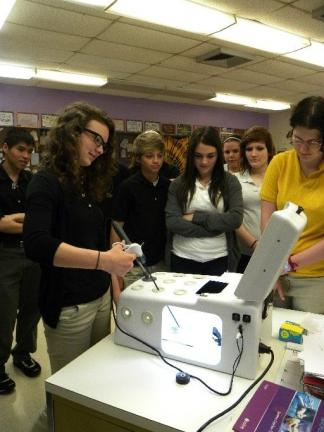 DANIELLE FOX/TIMES NEWS Panther Valley Senior Amanda Stocker experiences what it is like to perform minimally-invasive surgery on the laparoscopic trainer.