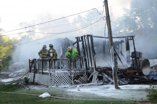 RON GOWER/TIMES NEWS Little remains of a mobile home occupied by Susan Dreste along Cherry Hill Road in Lower Towamensing after it was consumed by flames early last evening. A pet dog died in the fire. Officials said the fire was accidental in nature.