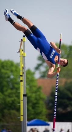 bob ford/times news Palmerton's Darris Rodrigues clears the bar in the Class AA pole vault on his way to a second place finish.