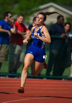 B OB FORD/TIMES NEWS Palmerton's Jessica Pereira makes the turn en route to a first place finish in the 3A 400 with a time of 58.91.