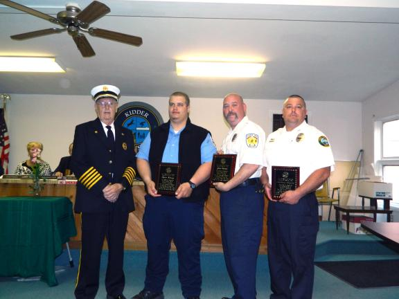 "JUDY DOLGOS-KRAMER/special to the times news Lake Harmony Fire Chief Ralph Lennon, left, presents plaques to, l-r, Ryan Kinsey, John Devine and Police Chief, Matt Kuzma for their ""selfless acts of heroism"" is assisting at a house fire in the Split…"
