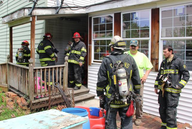 ANDREW LEINBENGUTH/TIMES NEWS Tamaqua firefighters respond to 27 W. Mauch Chunk St. in Tamaqua after a fire was discovered in a rear apartment. The blaze was extinguished before causing serious damage.