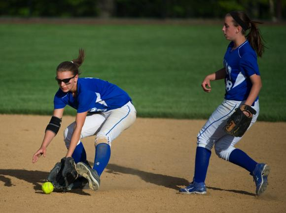 bob ford/times news Pleasant Valley's Jordan Meckes looks the ball into her glove as teammate Katie Lenhart (right) moves in from behind.