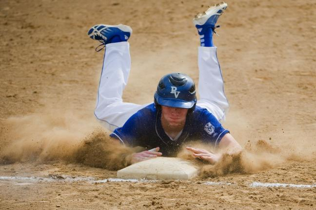 bob ford/times news Pleasant Valley's Jordan Caffrey slides safely into third base during Monday's District 11 Class AAAA playoff game against Bangor.