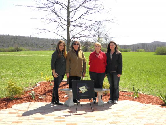 SPECIAL TO THE TIMES NEWS Memorial bricks and a bench have been dedicated at the Ross Township VanBuskirk-Haney Park. Present from the club were, from left, Emily Beade; Judy Breidinger, treasurer; Trish Bauer, chairperson; and Florine Serfass.