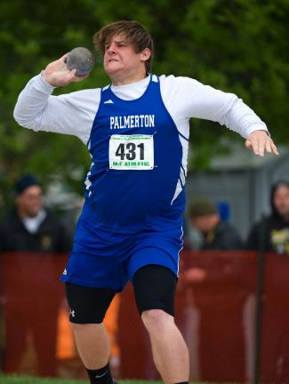 bob ford/times news Palmerton's John Snyder gets set to release a throw in the Class AA shot put at the PIAA State Track and Field Championships. Snyder finished eighth in the event to grab a medal.
