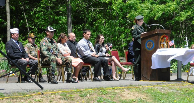"RON GOWER/TIMES NEWS Panther Valley High School student Megan Thomas reads ""Flanders Field"" during Memorial Day service at St. Joseph's Cemetery in White Bear, Summit Hill. Seated are, l-r, Henry Desrosiers, Director of Veterans Affairs in Carbon…"