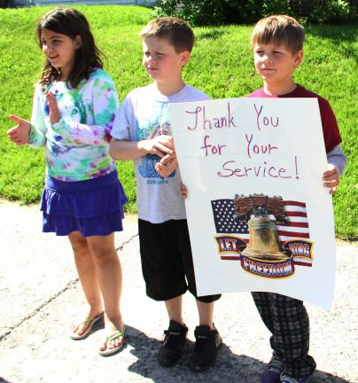 "ANDREW LEIBENGUTH/TIMES NEWS Holding a poster saying ""Thank You For Your Service"" are parade spectators, from left, Josie Schickram, 8; Jacob Riedel, 9; and Jerome Balliet, 9."