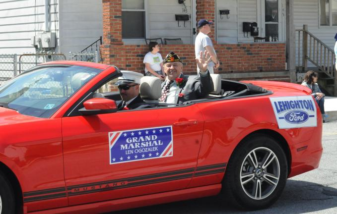 RON GOWER/TIMES NEWS Len Ogozalek, grand marshal of the Summit Hill Memorial Day parade, waves as he leads the parade riding in a convertible.