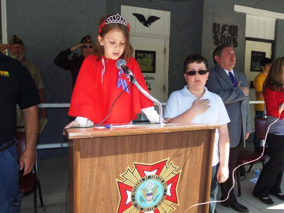 CAROL ZICKLER/SPECIAL TO THE TIMES NEWS Julia Romankow, 2013 Nesquehoning Poppy Queen and Anthony Ellis, Poppy King, lead the Pledge of Allegiance during the ceremony in front of the Nesquehoning VFW Post 8008.