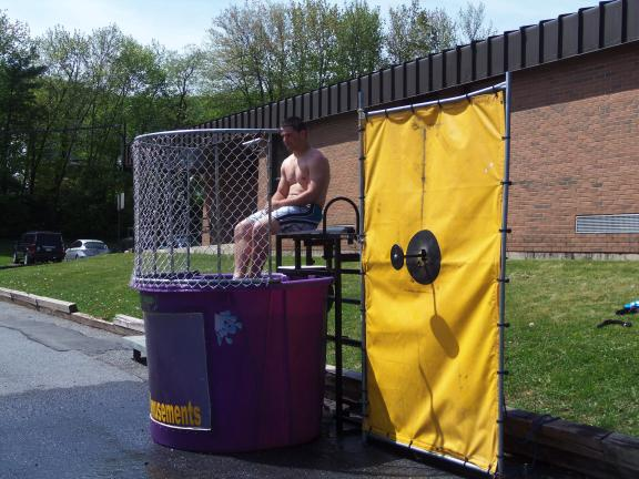 CAROL ZICKLER/SPECIAL TO THE TIMES NEWS Panther Valley High School senior Richie Smith poses in the dunk tank for Fun Day at the Panther Valley Elementary School. Each student got a chance to knock Smith into the water tank. Fun Day was held over…