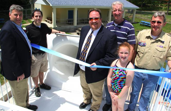 ANDREW LEIBENGUTH/TIMES NEWS Standing at the top of the water slide during the ribbon cutting are, from left, Tamaqua Mayor Chris Morrison, ESRC Jason Boris, Councilman Dave Mace, Dan Evans, and borough manager Kevin Steigerwalt. Also pictured is…