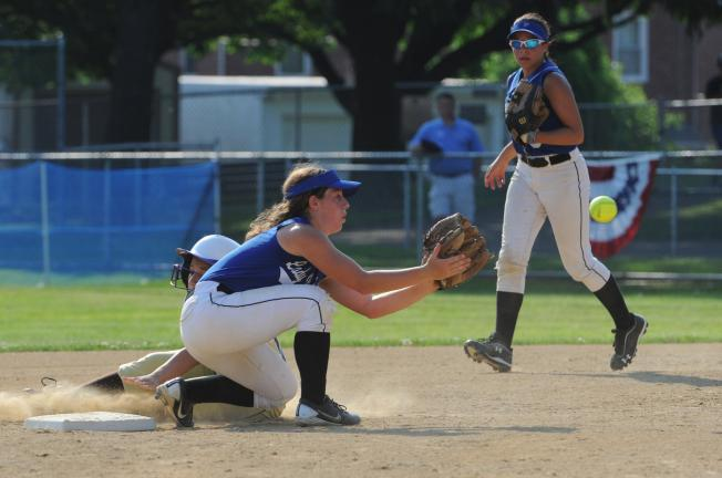 nancy scholz/special to the times news Palmerton's Janel Tracy waits for the ball to arrive as Bethlehem Catholic's Angelys Cotto slides safely into second base.
