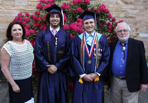 From left are Superintendent Carol Makuta, 2013 Class President Shane Mulligan, Class of 2013 Valedictorian Tyler Butkus and guest speaker R. Thomas Berner.