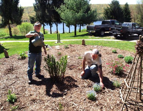 AL ZAGOFSKY/SPECIAL TO THE TIMES NEWS Master Gardeners John Kupec (left) and Mike Cormier plant native pollinator plants in the 25-foot diameter circular Pollinator-friendly Garden next to Penn State Extension's office at Mauch Chunk Lake.