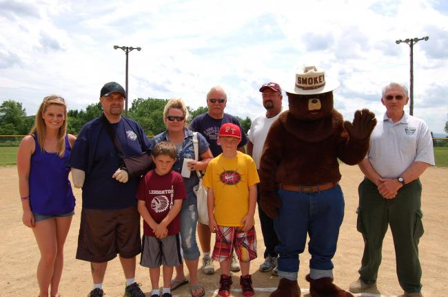 Gail Maholick/TIMES NEWS Presentation of the funds raised at the benefit baseball game between the Jim Thorpe Old-timers and the Franklin Township Old-timers was made by Jim Zurn, JT; and Wayne Wentz, FT. From left are, Nakea Beers, Dwain Gable,…