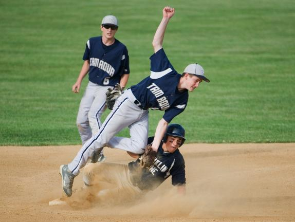 BOB FORD/TIMES NEWS Tamaqua's Bo Rottet puts the tag on Franklin Towne Charter High School's Stephen Callahan as he tries to steal second base in Monday's PIAA Class AAA first round game at Pine Grove. Tamaqua won the game 11-1 in six innings.