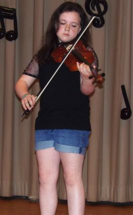 carol zickler/special to the times news @Caption Stand Alone:PV violin player Molly O'Connell plays violin solo at the annual talent show held at Panther Valley Elementary School.
