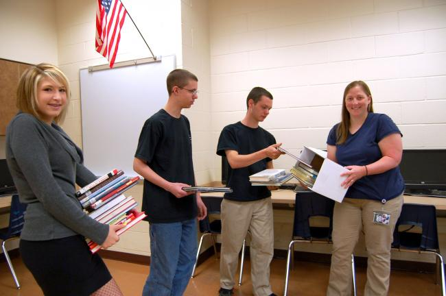 Gail Maholick/TIMES NEWS Carbon Career and Technical Institute, Jim Thorpe, downsized their library to make room for computers. Among those taking part in the packing up of books were, l-r, Avery Weber, Jeremiah Scott, Thomas Smith and Kim Bittle,…