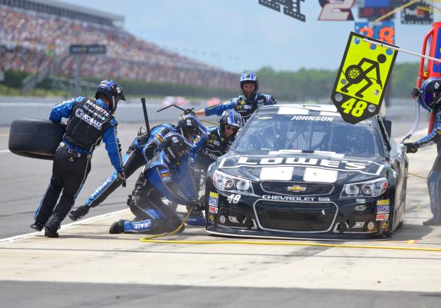 Jimmie Johnson gets some new tires during a pit stop Sunday at the Party in the Poconos 400. Johnson dominated the race to win for the third time this season. Bob Ford/ TIMES NEWS