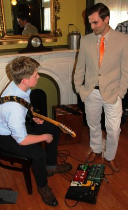 ANDREW LEIBENGUTH/TIMES NEWS Tamaqua elementary fifth-grade teacher Dylan Peters, a musician himself, talks with musician Damian Munos, an 11th grader, during the event.