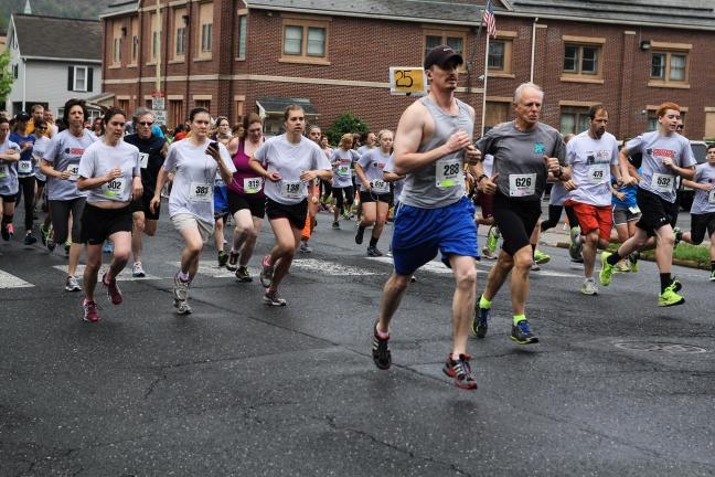 Special to the TIMES NEWS Runners take off at the start of the 12th annual Blue Mountain Health System 5K Road Race/Walk.